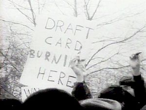 Draft_card_burning_NYC_1967